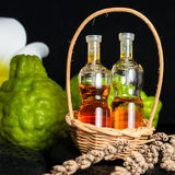 Aromatic spa concept of bottles essential oil in basket, flower, Royalty Free Stock Photography