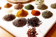 Aromatic spices. Different kind of oriental colorful and aromatic spices placed over the wood royalty free stock image