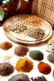 Aromatic spices. Different kind of oriental colorful and aromatic spices placed over the wood Stock Photo
