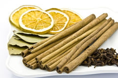 Aromatic spices. Cinnamon sticks, bay leaf, cloves, dried orange on plate stock images