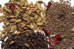 Aromatic spices background. Aromatic spices. Cardamom, coriander, cloves, pepper stock photos
