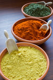 Aromatic spices. Colored aromatic spices in bowls royalty free stock photography