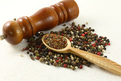 Aromatic spices pepper and grinder  on white Stock Photo