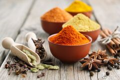 Free Aromatic Spices - Red Chili Pepper, Turmeric, Cardamom, Cinnamon, Cloves, Anise, Paprika. Ingredients For Cooking. Stock Photo - 169744460