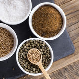 Aromatic spices in white bowls Stock Photo