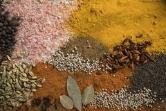Aromatic spices on wooden background royalty free stock photography