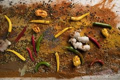 Aromatic spices on wooden background stock images