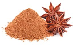 Aromatic star anise with ground spice. Over white background stock photography