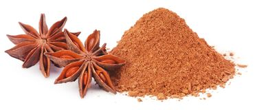 Aromatic star anise with ground spice. Over white background Royalty Free Stock Photo