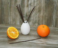 Aromatic sticks for home in white ceramic vase. Royalty Free Stock Photos