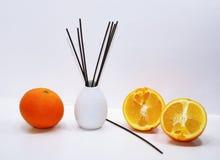 Aromatic sticks for home in white ceramic vase. Royalty Free Stock Image