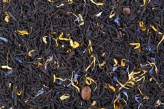 Aromatic tea with fruit, petals and coffee beans for your unique project. stock photography