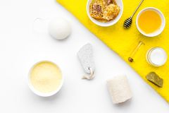 Aromatic theraphy and delicate skin care. Spa set based on honey on white background top view.  stock photography