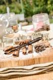 aromatic vanilla and cinnamon bark on wooden background Royalty Free Stock Photos