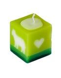 Aromatiskt stearinljus på den vita tabellen Royaltyfria Foton
