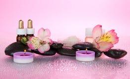 Aromatyczny olej, sól, świeczki, kamienie, kwiat zdjęcie royalty free