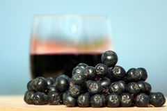 Aronia fruit and juice Stock Photos