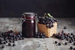 Aronia jam next to fresh berries Royalty Free Stock Photos