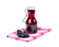 Aronia juice Aronia melanocarpa. In a glass of isolated white background royalty free stock photography