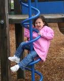 Around and around. Playing on the playground around and around Royalty Free Stock Image