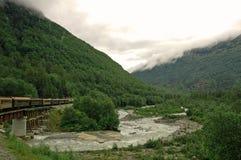Around the Bend. Train heading to downtown Skagway, Alaska Stock Photography