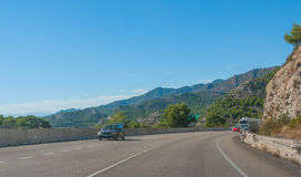 Around the bend - Sunshine on Spanish coastal highway.  Foothills and mountain ranges on the edges of continental Europe in Spain. Royalty Free Stock Image