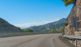 Around the bend - Sunshine on Spanish coastal highway. Foothills and mountain ranges on the edges of continental Europe in Spain. Around the bend - Sunshine on stock images