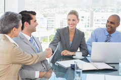 around business businessman camera desk having leaning looking meeting others sitting smiling team Στοκ Φωτογραφία