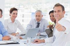 around business businessman camera desk having leaning looking meeting others sitting smiling team Στοκ φωτογραφία με δικαίωμα ελεύθερης χρήσης