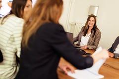 around business businessman camera desk having leaning looking meeting others sitting smiling team Στοκ εικόνα με δικαίωμα ελεύθερης χρήσης
