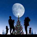Around the Christmas tree Stock Images