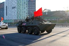 Around the city the BTR-82A armored personnel carrier with 30-mm gun 2A72 and a red flag goes. Moscow. Russia. May 3, 2017. The Victory Day parade rehearsal for royalty free stock images