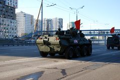 Around the city the BTR-82A armored personnel carrier with 30-mm gun 2A72 and a red flag goes. Moscow. Russia. May 3, 2017. The Victory Day parade rehearsal for royalty free stock photos