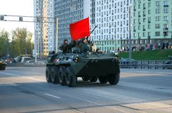 Around the city the BTR-82A armored personnel carrier with 30-mm gun 2A72 and a red flag goes. Moscow. Russia. May 3, 2017. The Victory Day parade rehearsal for royalty free stock image