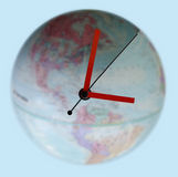 Around the clock. Clock on a globe stock illustration
