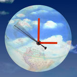 Around the clock. Clock on a globe stock photo