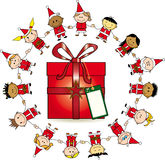 Around the gift. Group of childrens around a gift Royalty Free Stock Photo