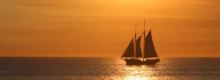 Sailing. Big sailboat at the sunset stock photos
