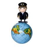 Around the world. Toy pilot standing on the globe Royalty Free Stock Photo