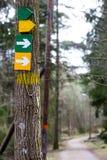 Arow signs on tree Stock Photo