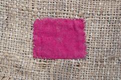 Arpillera con el remiendo rojo Imagenes de archivo