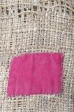 Arpillera con el remiendo rojo Foto de archivo