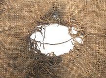 Arpillera rasgada decaída Imagenes de archivo