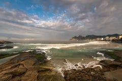 Arpoador Beach Rocks And Dramatic Sky Above Rio De Janeiro Royalty Free Stock Photos