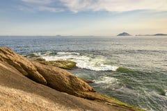 Arpoador beach stones. And islands Cagarras in Ipanema Stock Photography