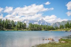 Arpy lake, Monte Bianco Mont Blanc in the background, Gran Paradiso National park, Aosta Valley in the Alps Italy. Arpy lake, Monte Bianco Mont Blanc in the Royalty Free Stock Photography