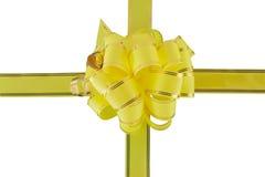 Arqueamiento amarillo del día de fiesta en blanco Imagenes de archivo