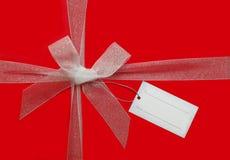 Arqueamiento de la cinta y tarjeta de regalo imagen de archivo
