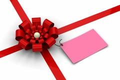 Arqueamiento rojo con la etiqueta rosada en blanco Imágenes de archivo libres de regalías