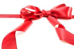 Arqueamiento rojo de la cinta del regalo fotografía de archivo libre de regalías